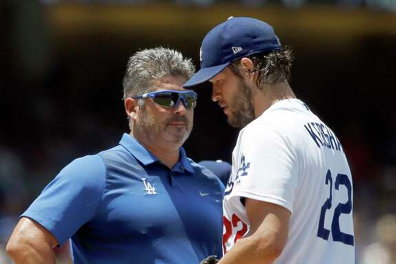 A sight Dodgers fans were hoping to avoid in 2017: Clayton Kershaw consulting with trainer Nathan Lucero before having to leave a game.