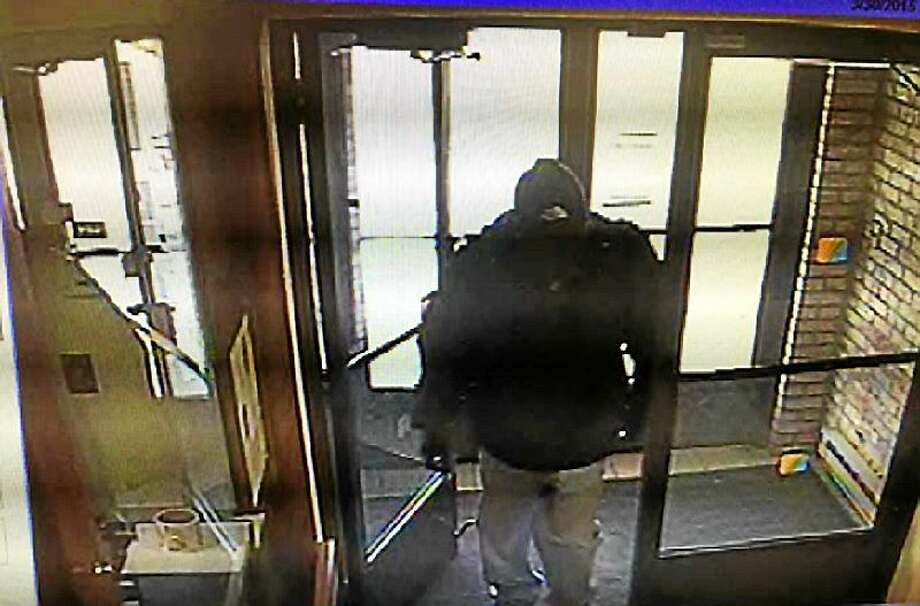 Surveillance photo of the suspect police are searching for in connection with Monday's bank robbery. Photo: Photo Courtesy Of The East Haven Police Department