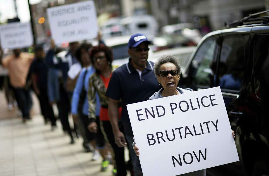 Protestors demonstrate outside the State Attorney's office calling for the continued investigation into the death of Freddie Gray on Wednesday in Baltimore. Activists stressed that they will continue to press for answers in the case of Gray, the 25-year-old black man whose death from a spinal-cord injury under mysterious circumstances while in police custody set off the riots. Photo: AP Photo   / AP