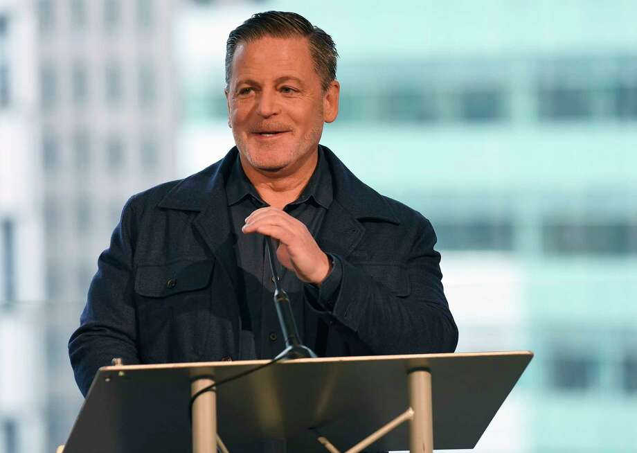 "FILE - In this Feb. 3, 2017, file photo, billionaire businessman Dan Gilbert speaks at a news conference in Detroit. Gilbert, founder of Quicken Loans Inc. and the majority owner of the Cleveland Cavaliers, apologized for his real estate company's controversial sign in downtown Detroit that says ""See Detroit Like We Do"" with an image of a majority white crowd. Gilbert posted on Facebook Sunday, July, 23, saying the ad was ""tone deaf"" and his Bedrock company ""screwed up badly."" (Clarence Tabb Jr./Detroit News via AP, File) Photo: Clarence Tabb Jr., MBO / Detroit News"