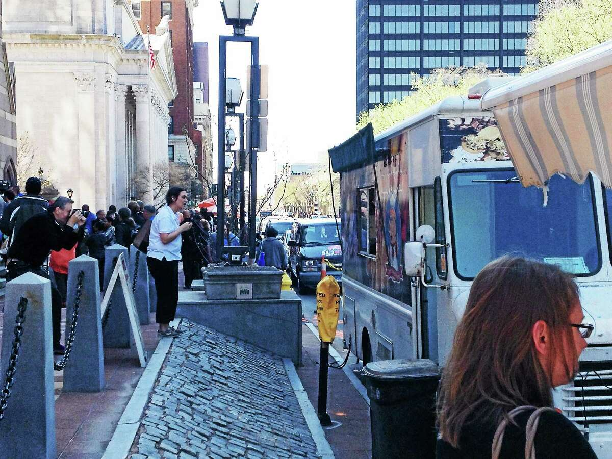 Ricky D's Rib Shack's food truck on Church Street Wednesday in New Haven. In the foreground is the awning from the Ay! Arepa food truck.