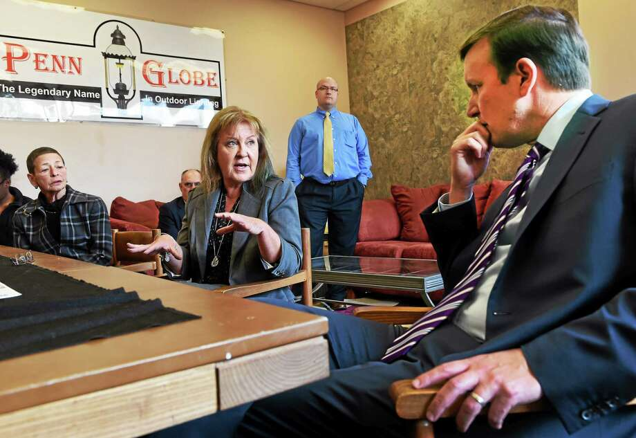 Marcia Lafemina, president of Penn Globe, a family-run and woman-owned manufacturer of energy saving lighting systems and fixtures in North Branford, speaks with U.S. Sen. Chris Murphy, D-Conn., Monday. Photo: Peter Hvizdak — New Haven Register    / ©2015 Peter Hvizdak