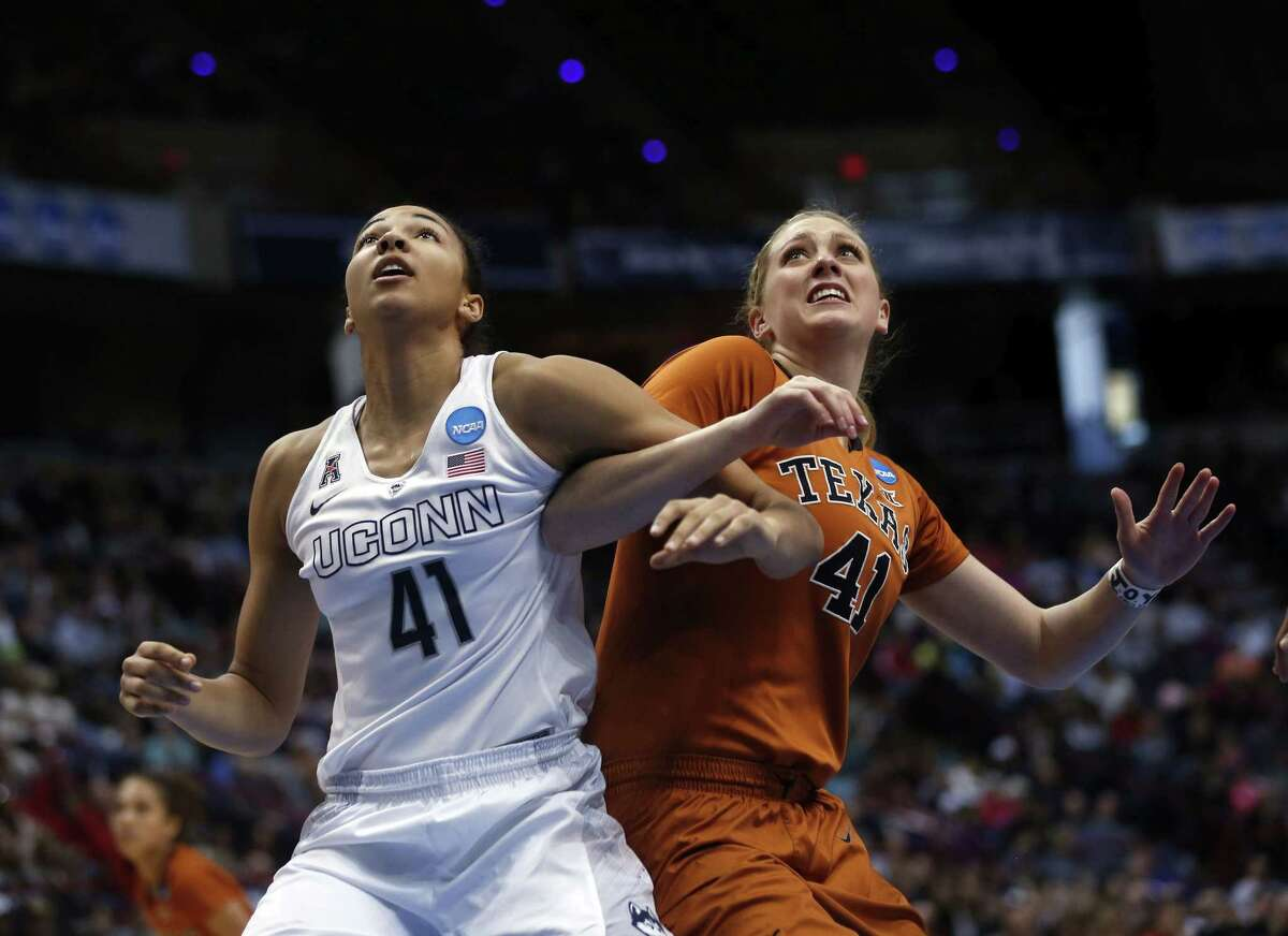 Connecticut center Kiah Stokes (41) and Texas' Lilley Vander Zee battle for position during the second half of a women's college basketball regional semifinal game in the NCAA Tournament on Saturday, March 28, 2015, in Albany, N.Y. (AP Photo/Mike Groll)