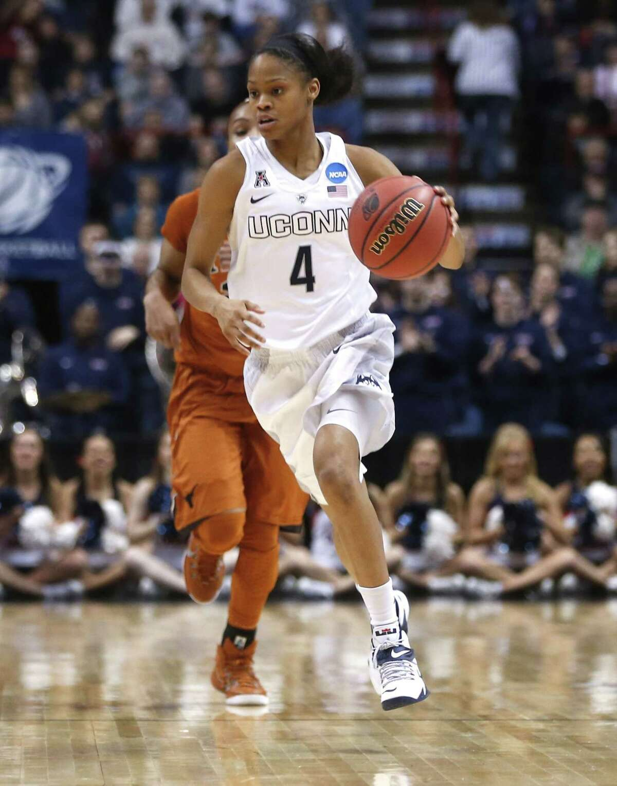 Connecticut guard Moriah Jefferson (4) moves the ball against Texas during the first half of a women's college basketball regional semifinal game in the NCAA Tournament on Saturday, March 28, 2015, in Albany, N.Y. (AP Photo/Mike Groll)