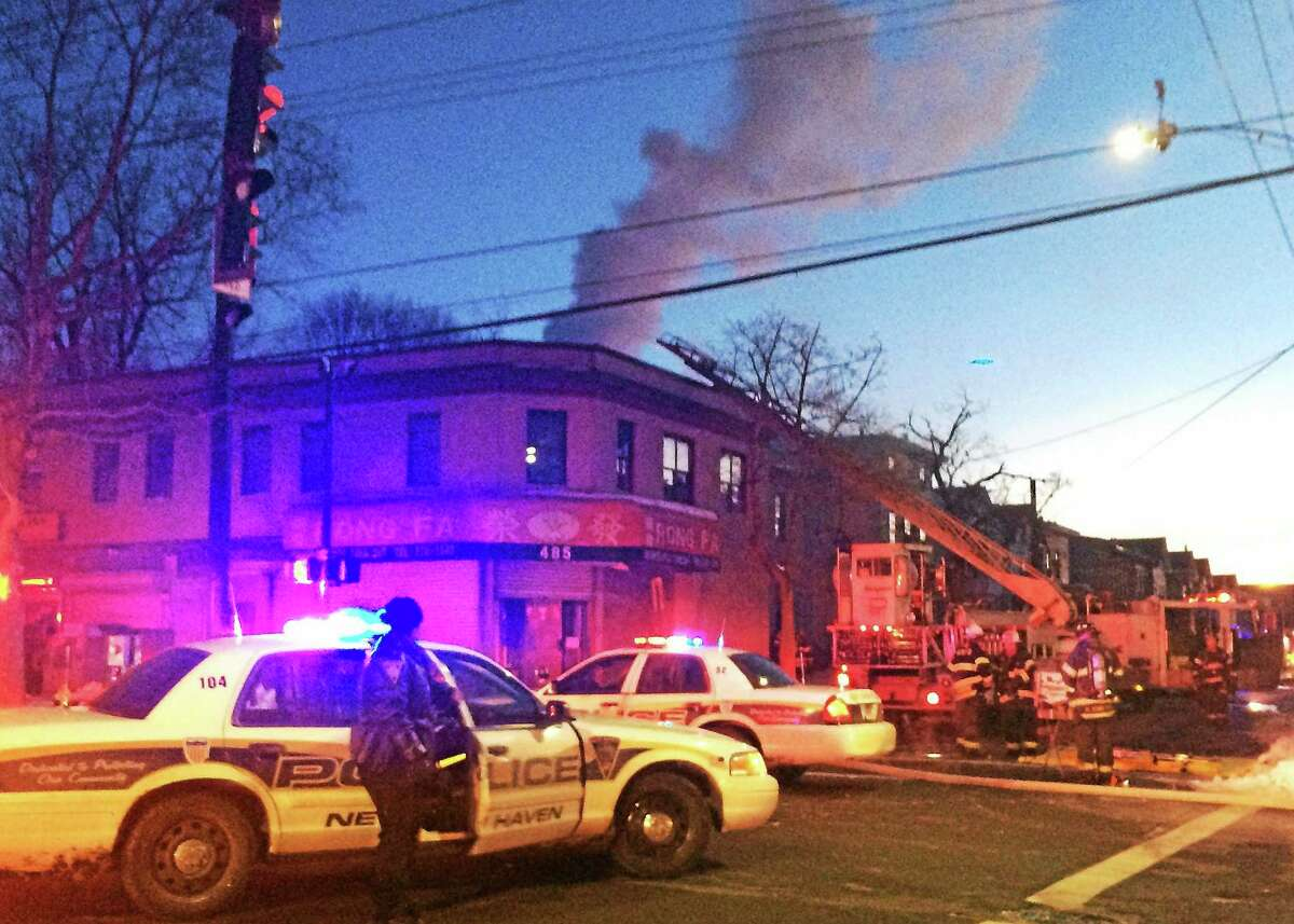 A smoky, two-alarm fire forced 20 people from their apartments at 95 Spring St. early Thursday morning. After fleeing the fire, residents had to take shelter in a transit bus to stay warm.