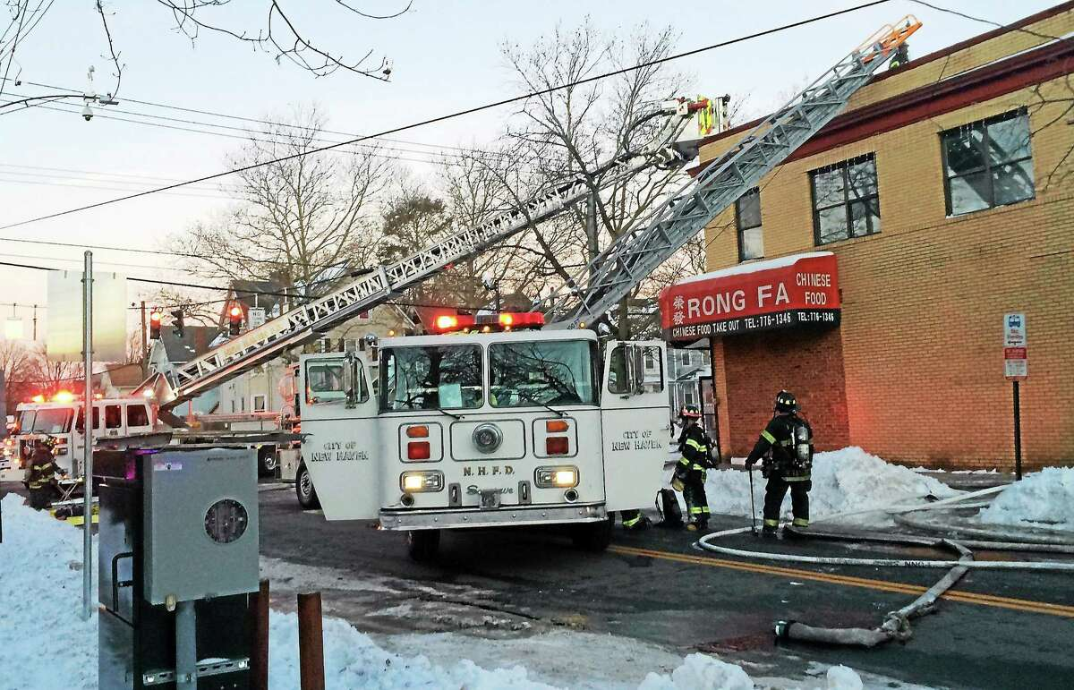 A smoky, two-alarm fire forced 20 people from their apartments at 95 Spring St. early Thursday morning. Several streets near the intersection of Howard Avenue and Spring Street were blocked as crews fought the flames.