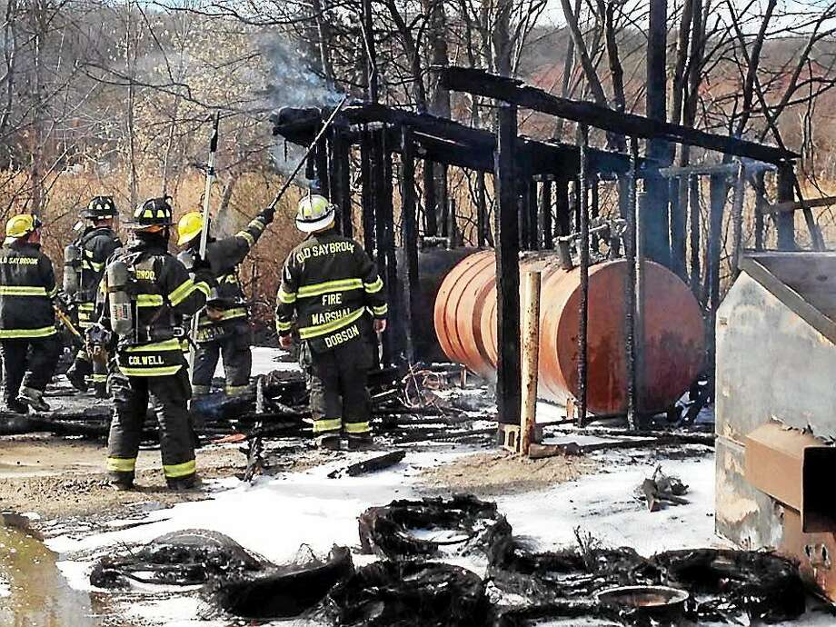 Fire crews from Old Saybrook, Westbrook and Old Lyme battled a blaze Wednesday afternoon at H.A. Latham Movers, 175 Elm St. in Old Saybrook that involved a dumpster, dozens of discarded truck tires and a large diesel fuel tank as well as woods and brush in the area. Photo: (Photo Courtesy Of The Old Saybrook Fire Department)