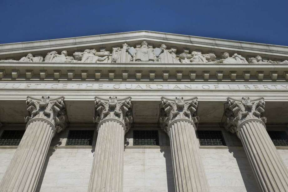 The Supreme Court is meeting for the final time until the fall to decide three remaining cases and add some new ones for the term that starts in October. Photo: AP Photo/Jacquelyn Martin   / AP