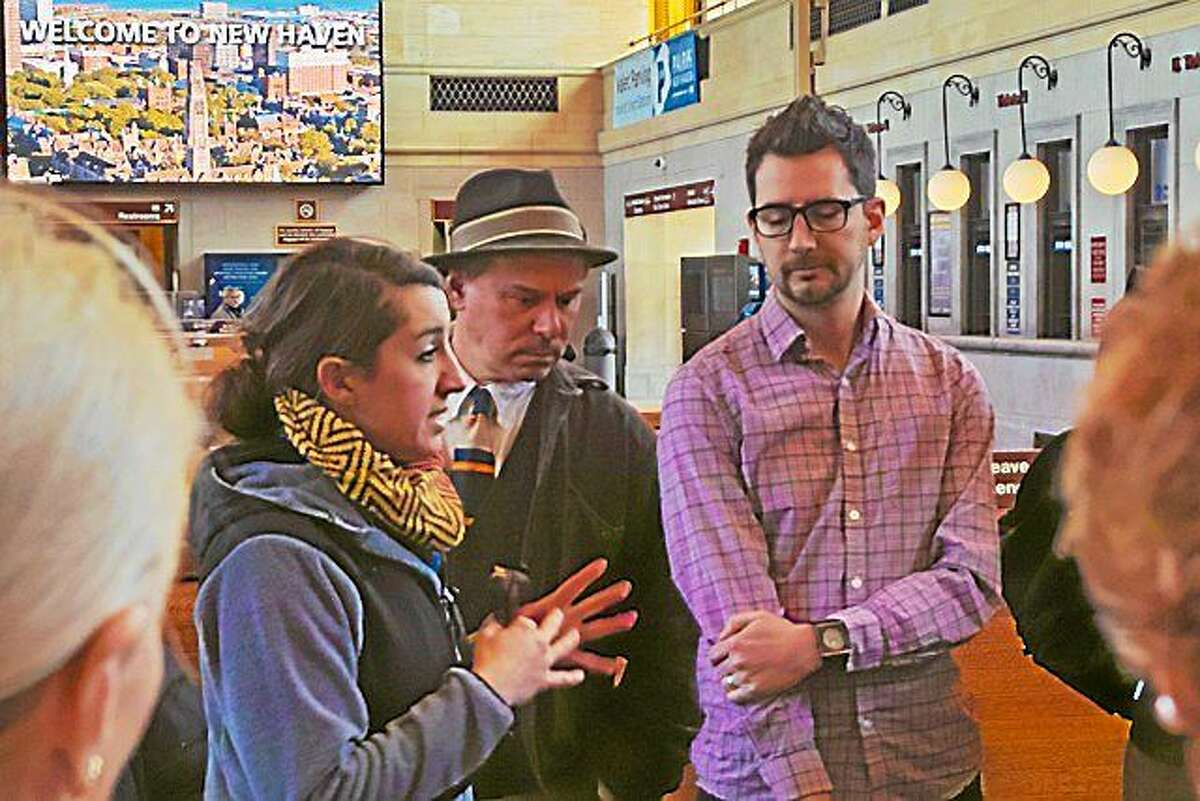 Liz Bartek of R.J. Julia Booksellers, Chris Arnott and Andrew Bardin Williams at the start of the New Haven literary tour in Union Station.