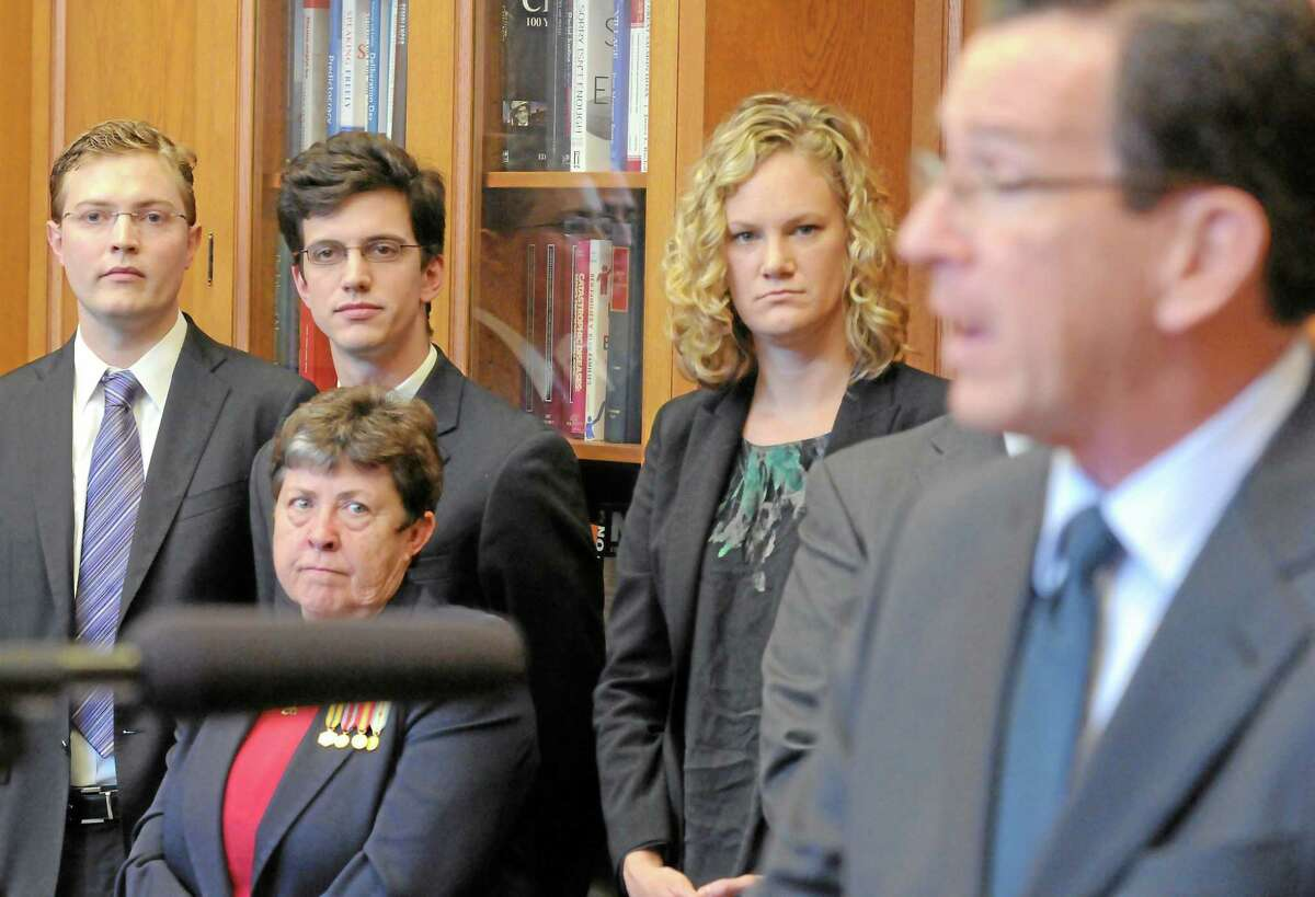 Gov. Dannel Malloy signs a bill into law in a ceremony at the Yale Law School in this 2012 file photo.
