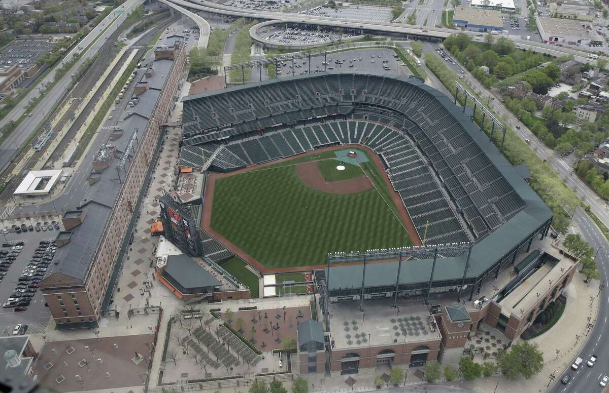 In this aerial photo, Baltimore's Oriole Park at Camden Yards sits empty on Tuesday as unrest that occurred after Freddie Gray's funeral continues into a second day.