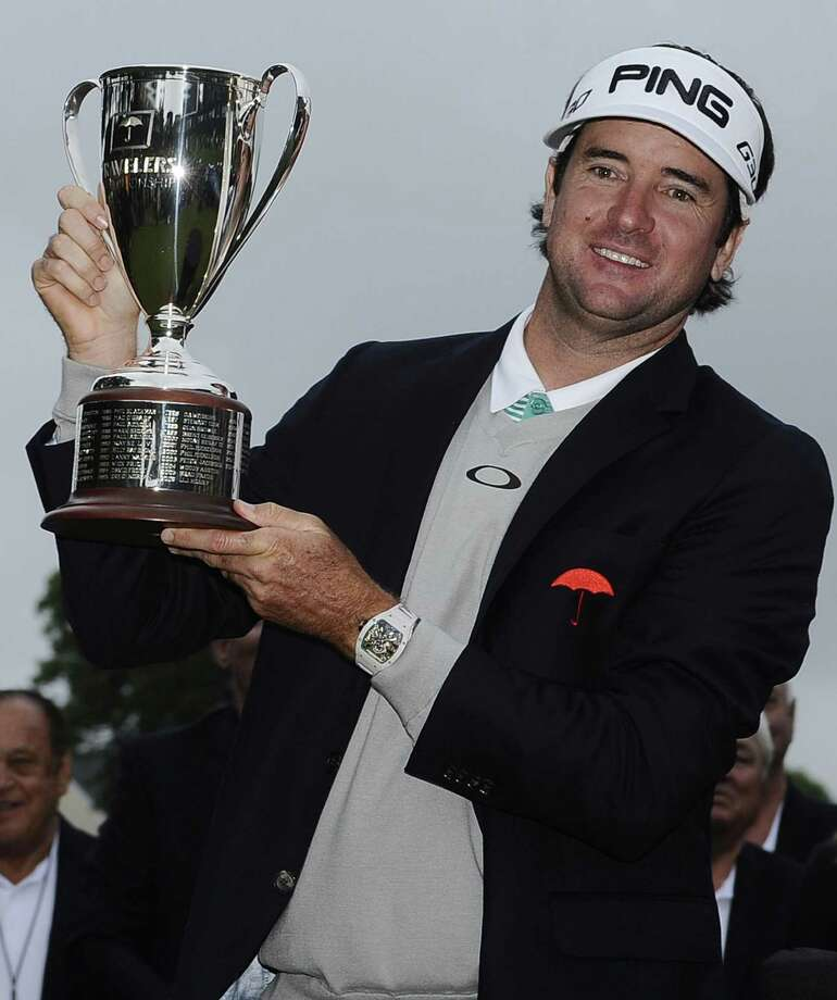 Bubba Watson holds the championship trophy after winning the Travelers Championship on Sunday in Cromwell. Photo: Jessica Hill — The Associated Press   / AP2015