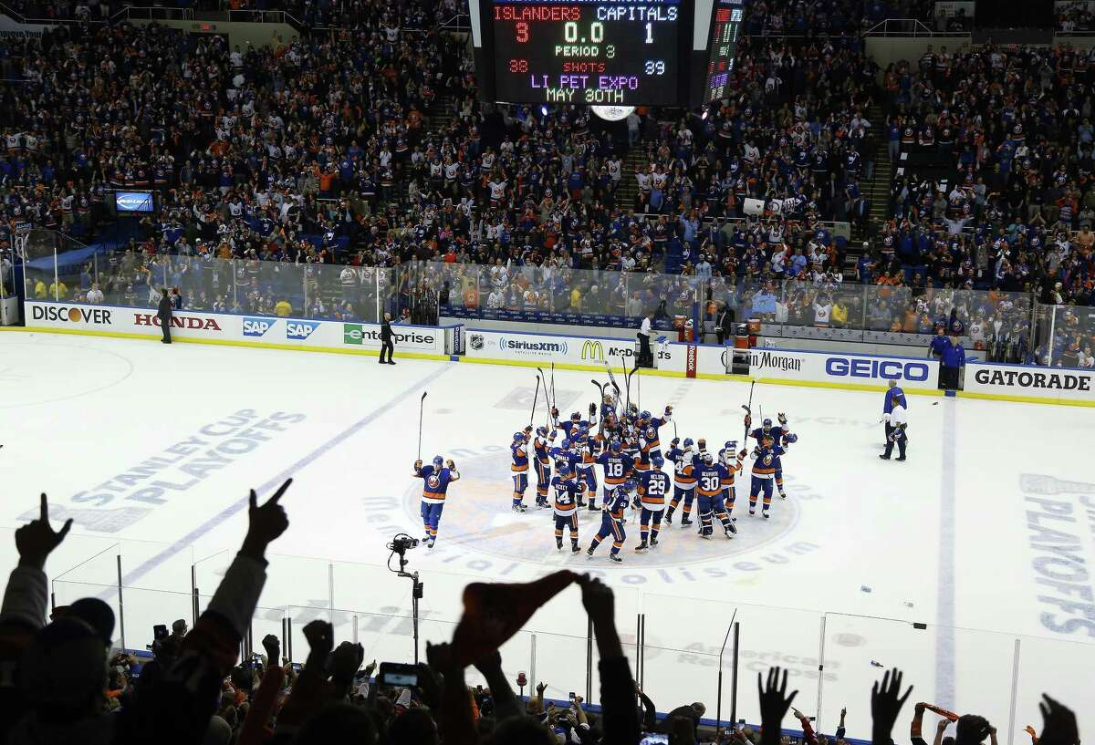 The New York Islanders celebrate at center ice after beating the Washington Capitals 3-1 in Game 6 of the first round of the Stanley Cup playoffs on Saturday in Uniondale, N.Y.