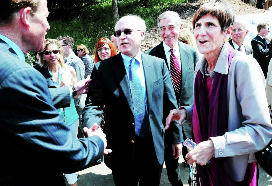 In this June 2013 photo, U.S. Sen. Richard Blumenthal, left, and U.S. Rep. Rosa DeLauro, right, speak with Dr. Leonard Bell, center, CEO of Alexion Pharmaceuticals, during a ground-breaking for the company's future global headquarters in New Haven. Photo: Arnold Gold — New Haven Register FILE PHOTO
