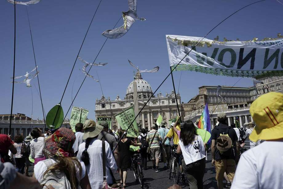 """People march in St. Peter's Square, at the Vatican, Sunday, June 28, 2015. Greeting people Sunday from his studio window, Francis praised a few hundred people who marched under the banner """"one Earth, one family."""" Marchers included Christians, Muslims, Jews, Hindus and others. Photo: AP Photo/Andrew Medichini   / AP"""