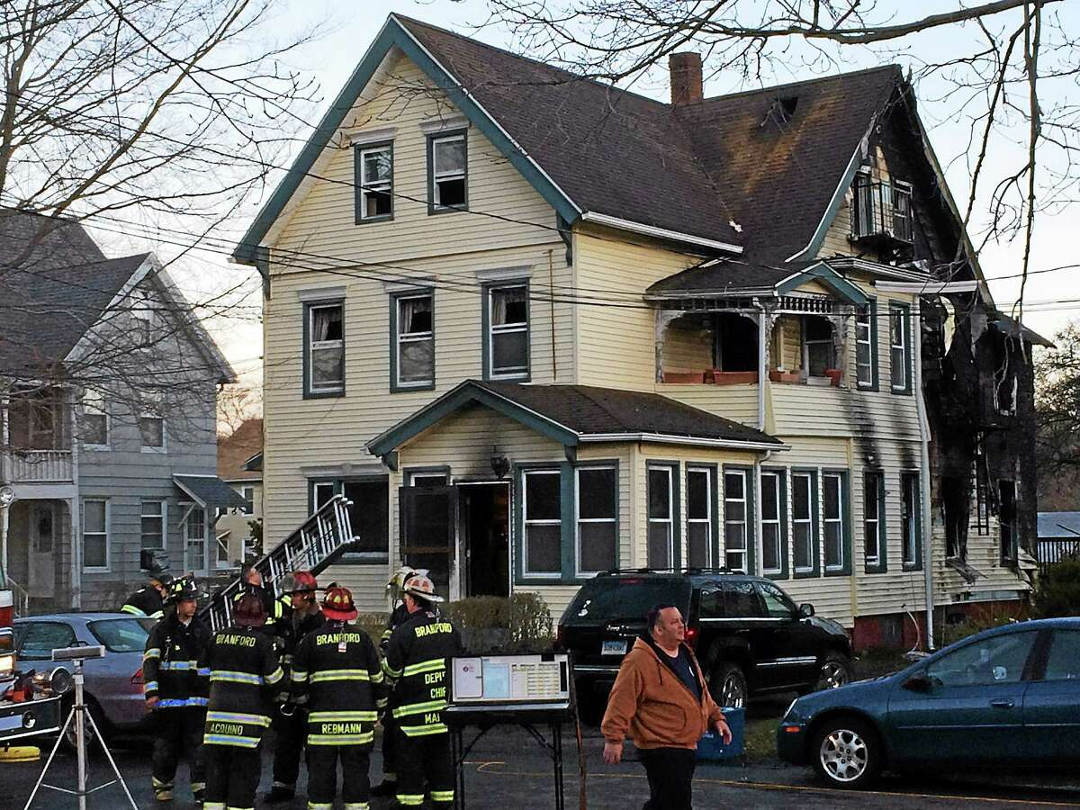 A major fire heavily damaged a home at 674 Main St. in Branford early Tuesday morning. Eight people escaped the flames but six cats were found dead in the house.
