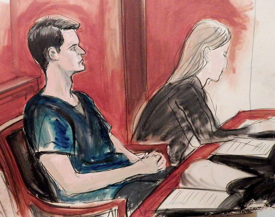 In this courtroom sketch, Ross William Ulbricht is seated in court and awaits sentencing Friday, May 29, 2015 in New York. The San Francisco man who created the online drug-selling site Silk Road was sentenced to life in prison by a judge who cited six deaths that resulted from drugs bought on his website and five people he tried to have killed. Photo: (AP Photo/Elizabeth Williams) / FRE 142054 AP