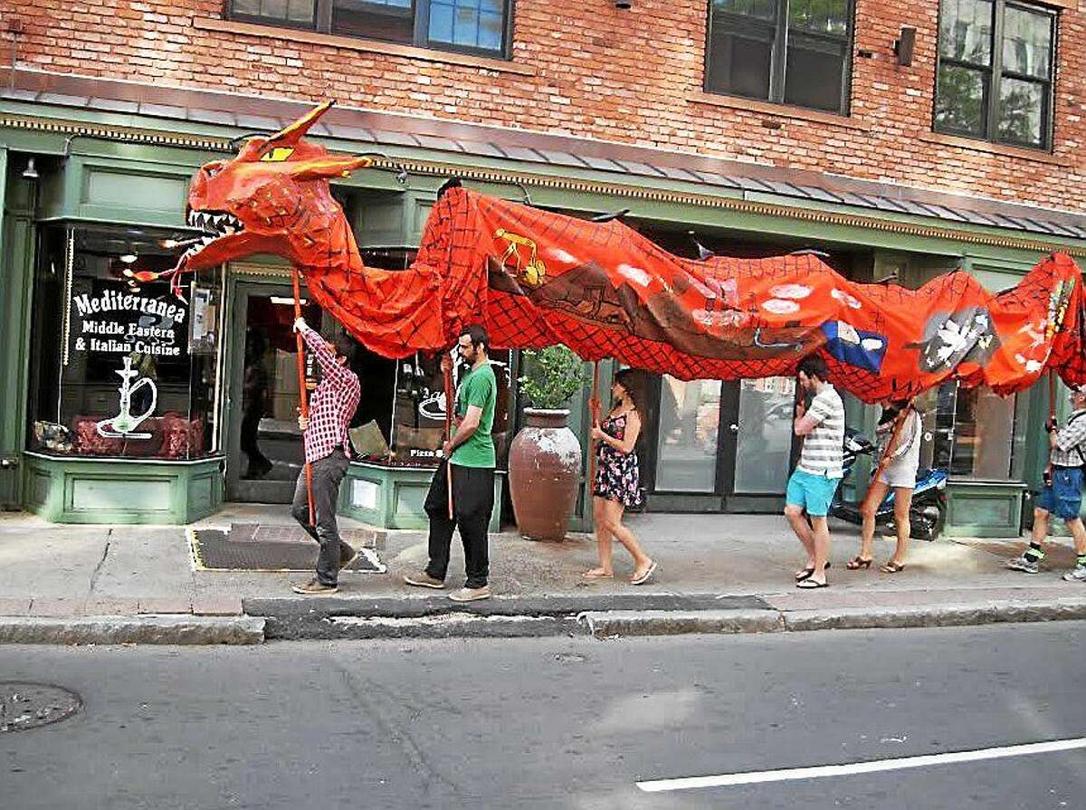 The 50-foot parade dragon is carried by 10 people and winds through the streets during the march.