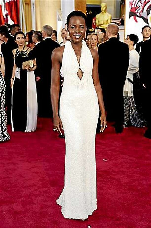 FILE - In this Feb. 22, 2015 file photo, actress Lupita Nyong'o arrives at the Oscars wearing a dress made of pearls at the Dolby Theatre in Los Angeles.  Los Angeles sheriff's detectives are investigating the theft of the $150,000 custom Calvin Klein dress worn by Nyong'o at the 2015 Academy Awards. The dress was reported stolen from Nyong'o's West Hollywood hotel room late on Wednesday Feb. 25, 2015. (Photo by Chris Pizzello/Invision/AP, File) Photo: Chris Pizzello/Invision/AP / Invision