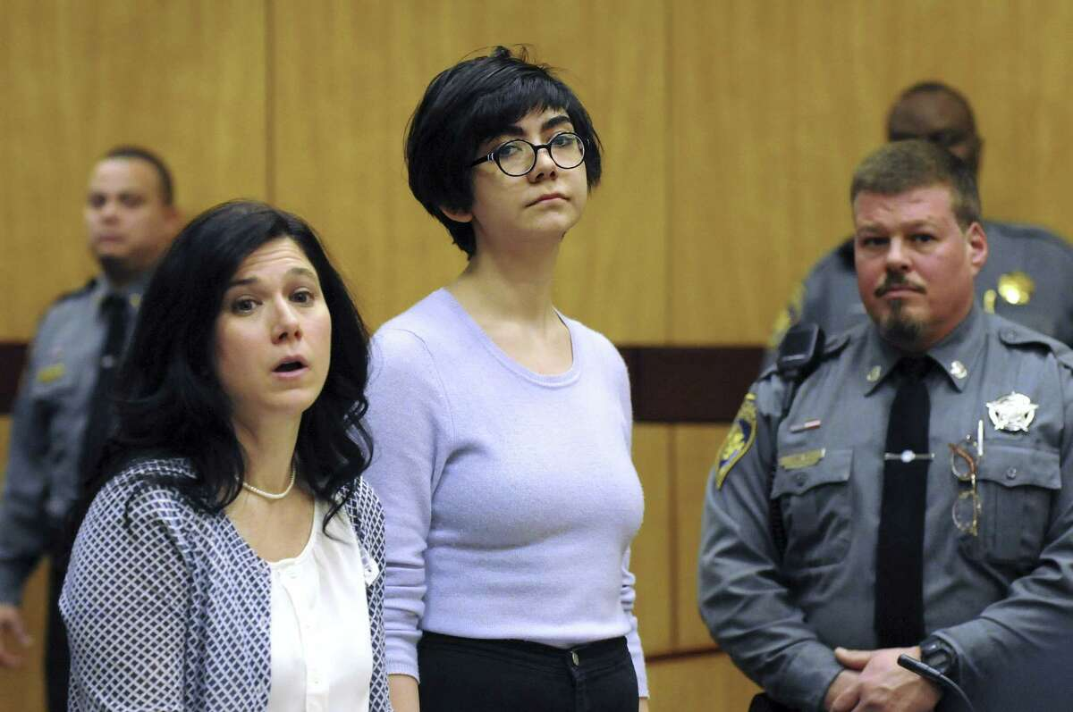 Wesleyan University sophomore and neuroscience major Rama Agha Al Nakib, 20, stands during her arraignment at Middletown, Conn., Superior Court on Wednesday, Feb. 25, 2015, for possession of controlled substances and other charges. She is one of four students arrested after a rash of illnesses on campus linked to the party drug Molly.