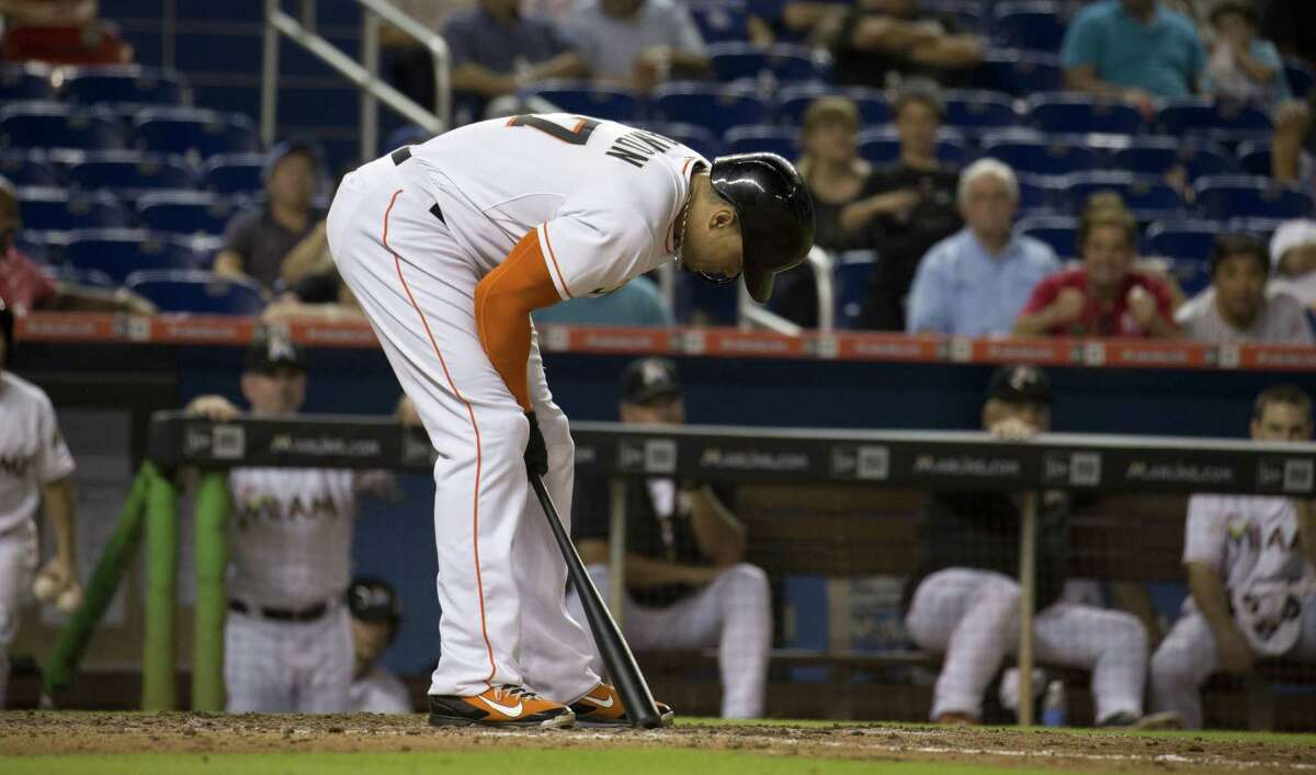 Marlins slugger Giancarlo Stanton reacts after striking out during the ninth inning of Friday's game in Miami against the Los Angeles Dodgers.