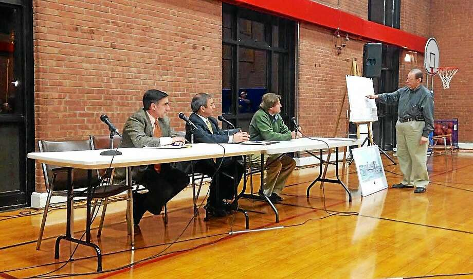 Seated from left, Maplewood attorney Bernard Pellegrino, North Haven First Selectman Michael Freda and Maplewood Vice President of Acquisitions and Development Andrew Deery. Photo: KATE RAMUNNI — NEW HAVEN REGISTER