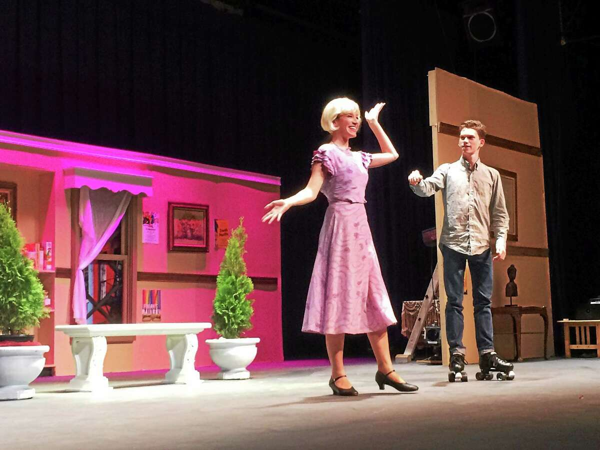 "West Haven High School students Whitney Bibbens and Tommy Nelson rehearse for the WHHS Theatre Workshop's production of ""The Drowsy Chaperone,"" which runs from April 30 to May 2, with shows at 7:30 p.m. each day and a 2 p.m. matinee Saturday that is free for senior citizens."