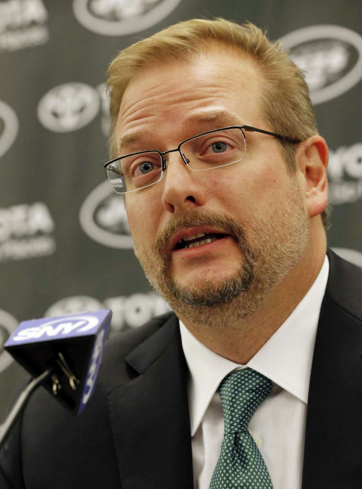 New York Jets general manager Mike Maccagnan speaks during a press conference on Jan. 21 in Florham Park, N.J.