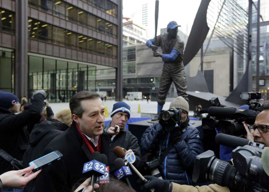 Chicago Cubs chairman Tom Ricketts speaks to the media next to the statue of Hall of Famer Ernie Banks in Daley Plaza as fans get their first chance to pay their respects on Wednesday in Chicago. Photo: Spencer Green — The Associated Press   / AP
