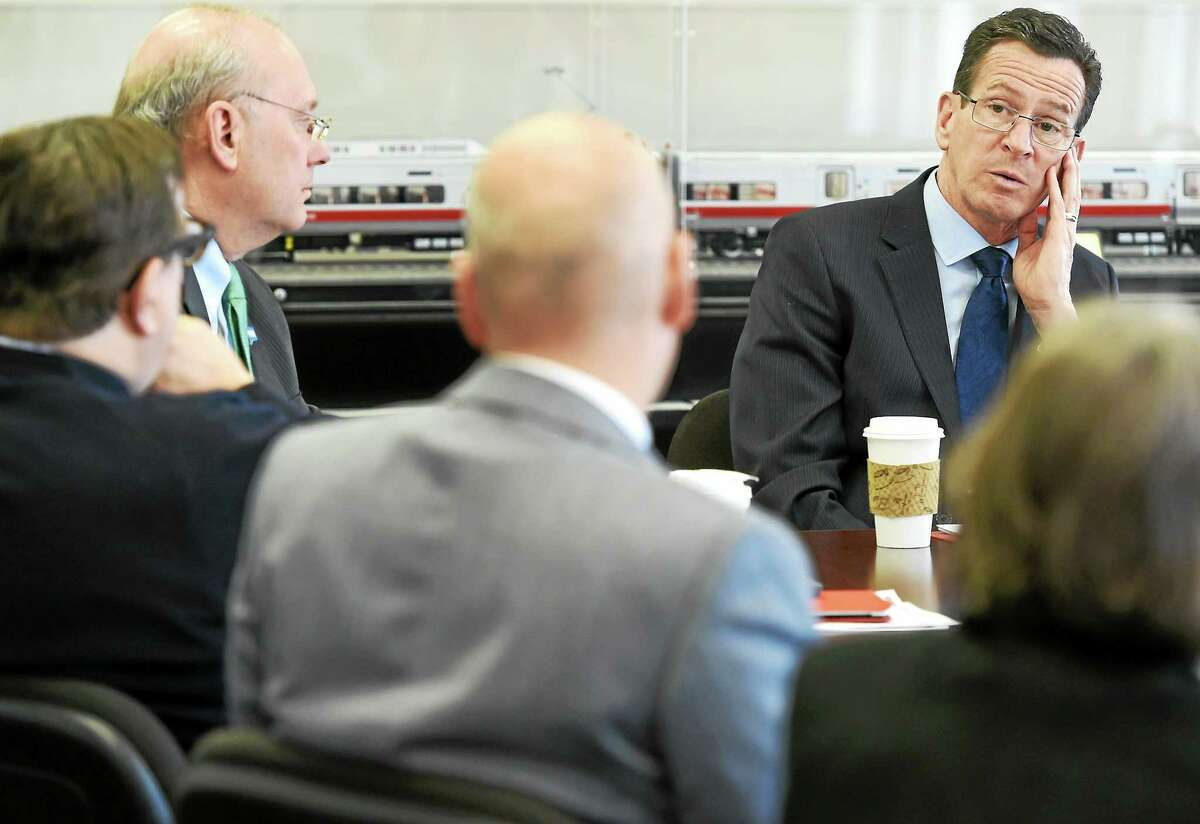 Governor Dannel P. Malloy hosts a meeting with business leaders and state and local officials at Union Station in New Haven Thursday.