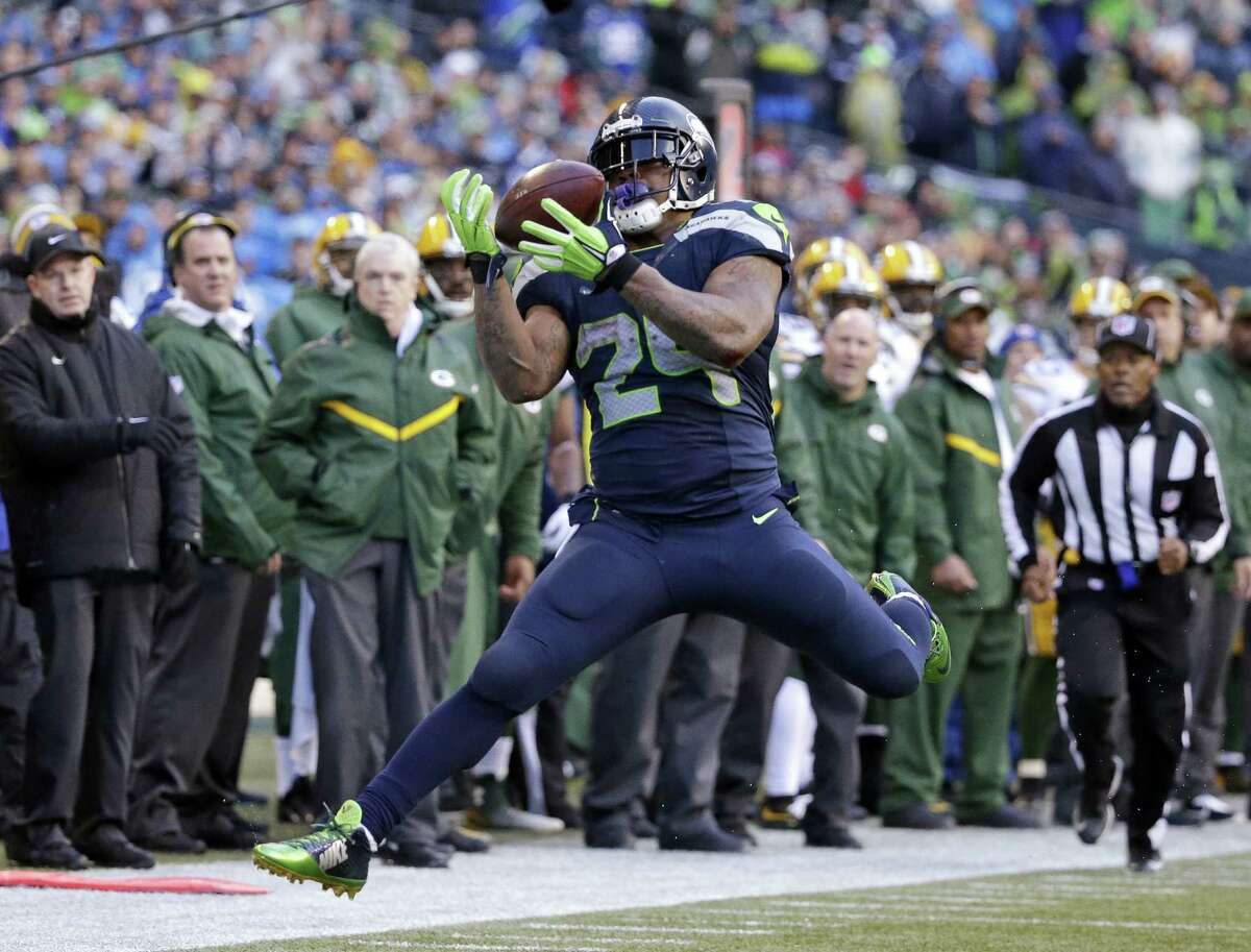 The Seahawks' Marshawn Lynch makes a catch against the Green Bay Packers during the second half of the NFC championship game on Jan. 18 in Seattle.