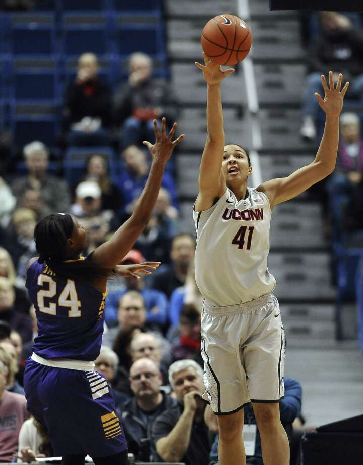 UConn's  Kiah Stokes, right, blocks a shot attempt by East Carolina's I'Tiana Taylor, left, during Wednesday's game in Hartford. Photo: Jessica Hill  — The Associated Press   / FR125654 AP