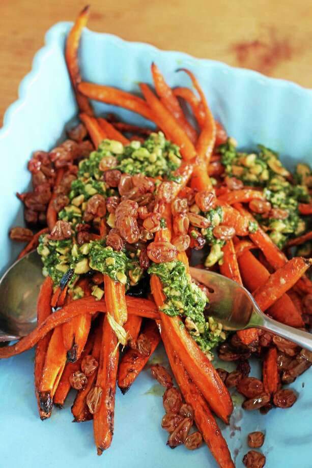 Roasted Carrots With Port Raisins and Spicy Peanut-Herb Sauce Photo: Matthew Mead — The Associated Press   / FR170582 AP