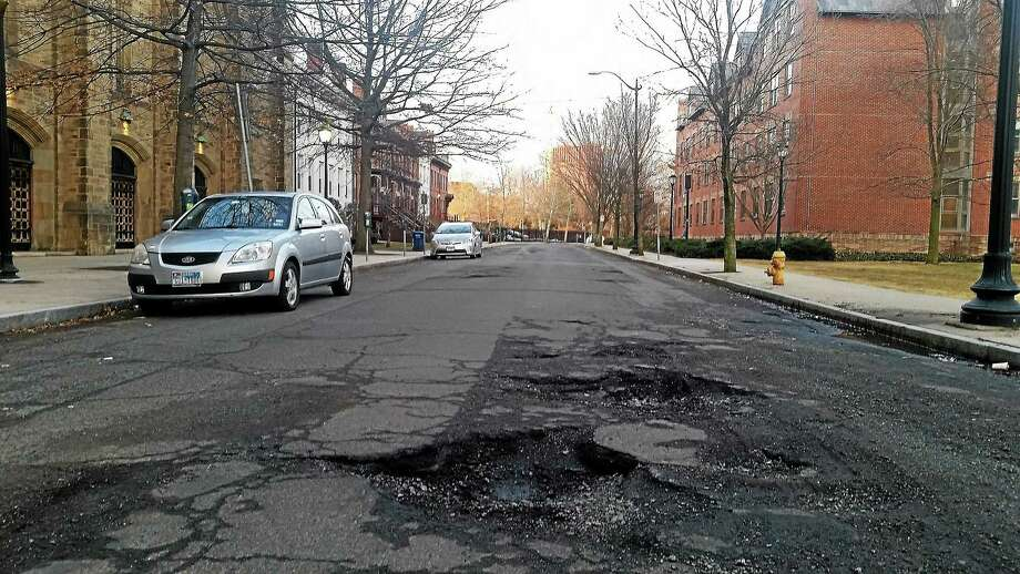 A pothole in New Haven Photo: Evan Lips — New Haven Register)