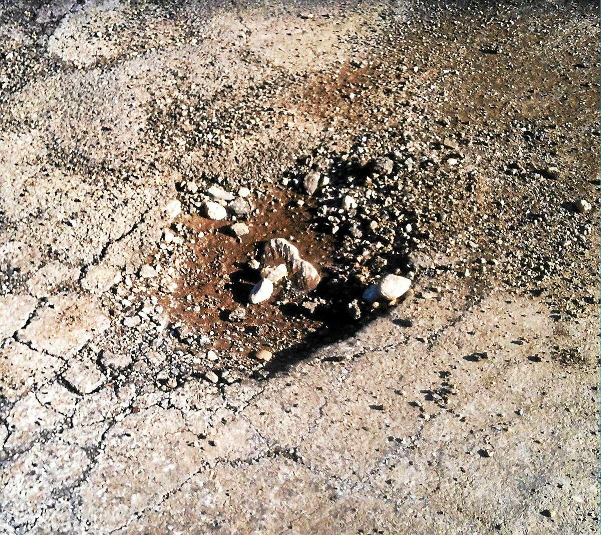 Helen Bennett — New Haven RegisterA pothole in Orange