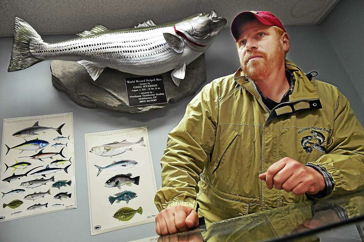 Greg Myerson, in front of a replica of the record bass he caught in 2011.