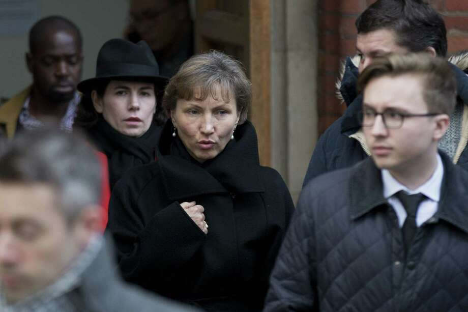 """Marina Litvinenko, center, the widow of former Russian intelligence officer Alexander Litvinenko, and their son Anatoly, right, leave for the lunch break in proceedings at the Royal Courts of Justice in London on Jan. 27, 2015. A British judge opened an inquiry Tuesday into the death of Alexander Litvinenko, declaring the issues raised in the poisoning death of the former Russian intelligence agent to be of the """"utmost gravity."""" Photo: AP Photo/Matt Dunham   / AP"""
