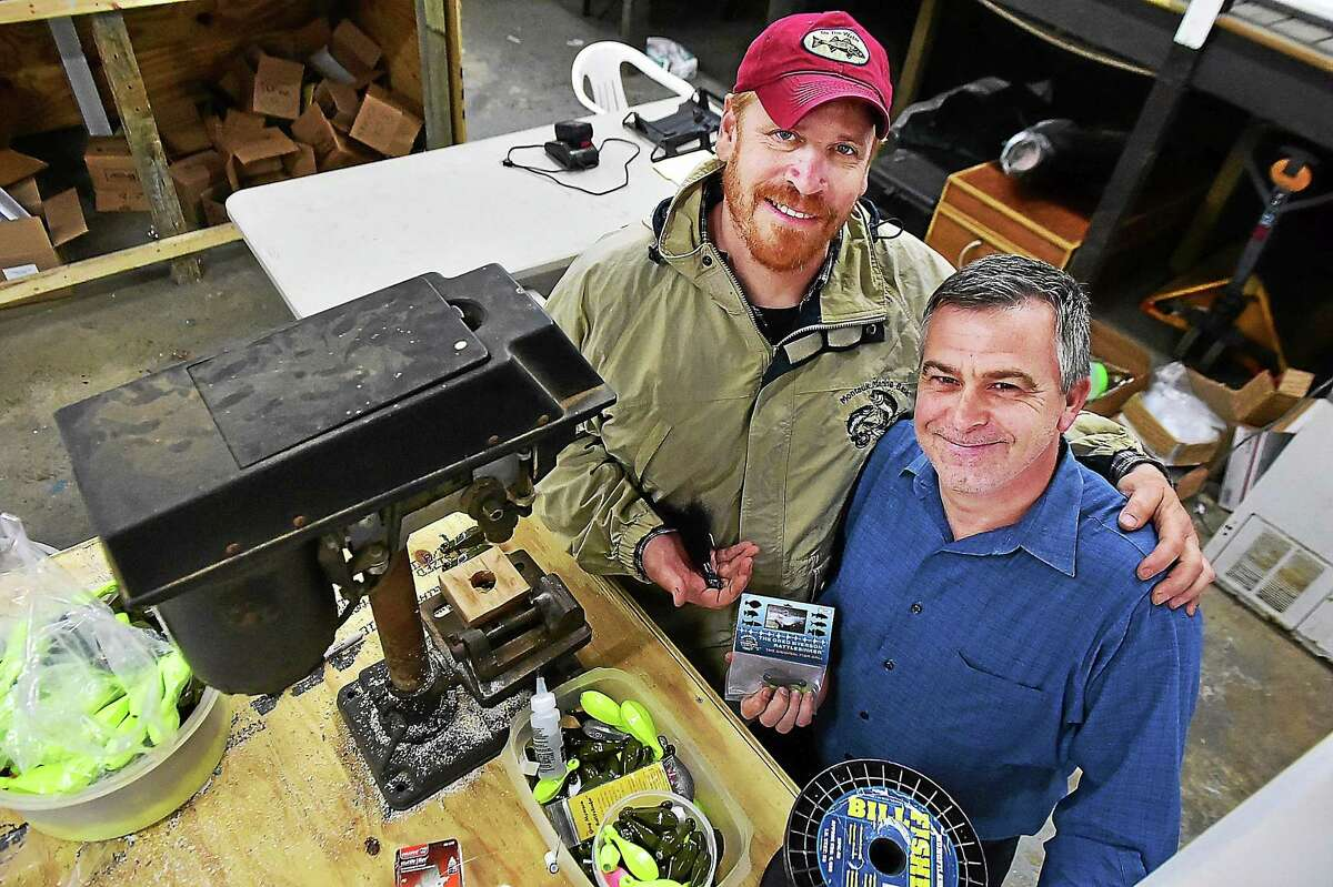 Myerson, left, and Vincent Van Oss, owners of The World Record Striper Company in Westbrook.