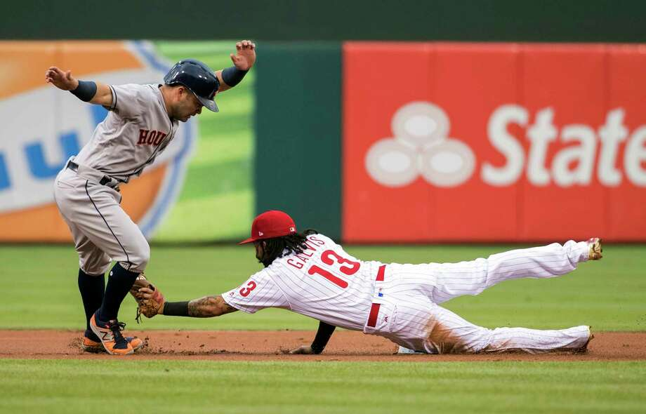 The only success the Phillies had in getting Jose Altuve off the bases came in the first inning when he was tagged  out by shortstop Freddy Galvis after reaching on a walk. He had two doubles and two singles in his next four at-bats. Photo: Chris Szagola, FRE / FR170982 AP
