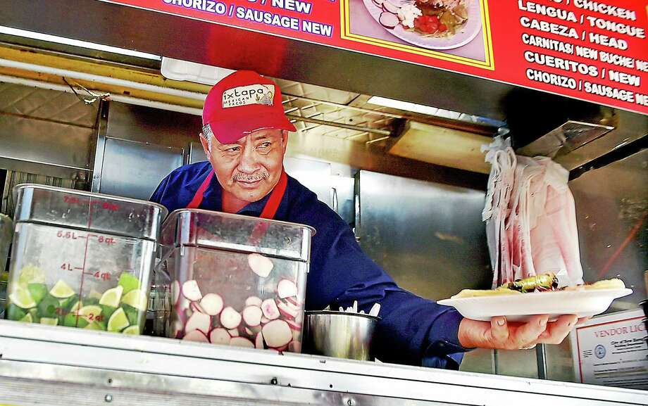 The New Haven Food Truck Festival on New Haven's  historic Long Wharf waterfront will be held from 11 a.m. to 6 p.m. on Saturday, May 30 and Sunday, May 31, 2015.  The event is organized by the City of New Haven, Small Business Service Center and will feature local food trucks, live music, crafts and amusement rides. Tickets are $5 per person, children age 17 and under are free. Photo: (Catherine Avalone/New Haven Register)    / New Haven RegisterThe Middletown Press