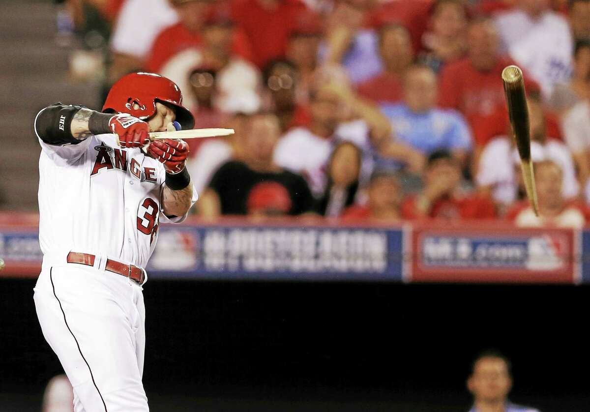 Los Angeles Angels outfielder Josh Hamilton breaks his bat during Game 2 of the ALDS against the Kansas City Royals on Oct. 3 in Anaheim, Calif.