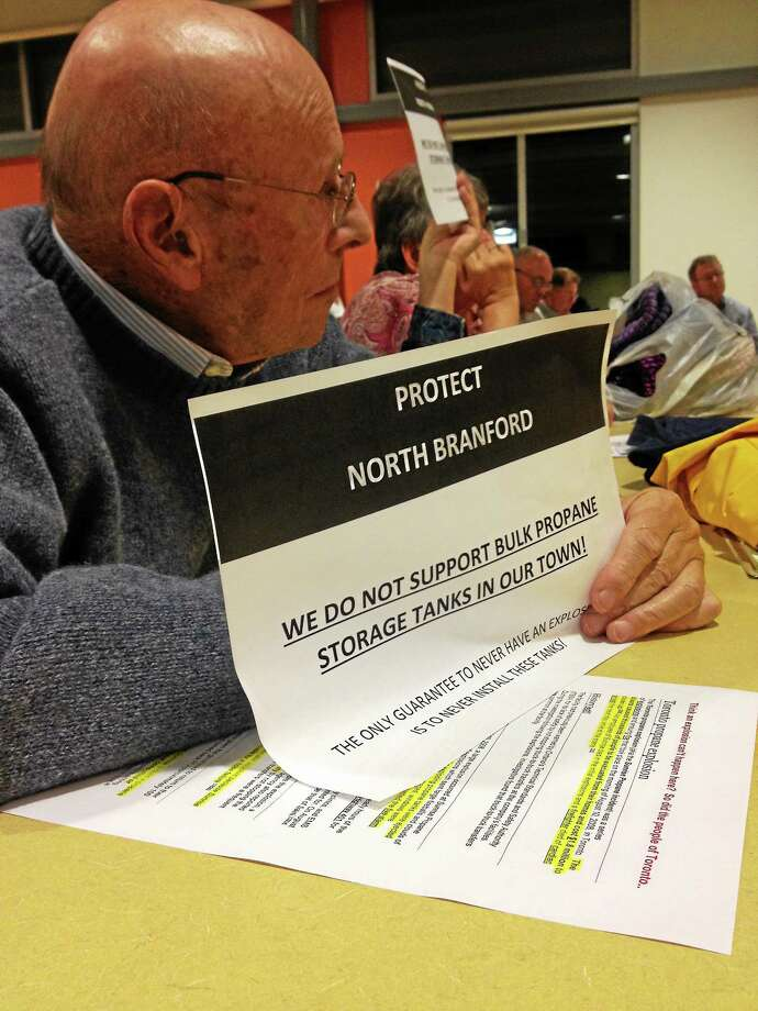 North Branford resident Bob van Marx holds a sign in protest at a Planning and Zoning meeting to discuss the J.J. Sullivan's proposed propane facility. Photo: Kristin Stoller — New Haven Register FILE PHOTO