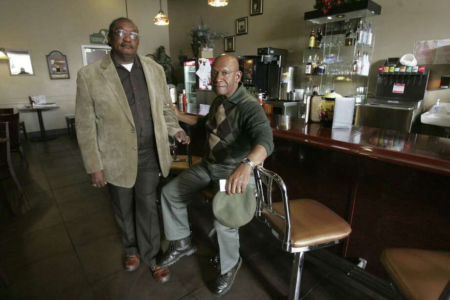 """FILE - In this March 5, 2009, file photo, the Rev. W. T.  """"Dub"""" Massey, right, and Willie McLeod, left, pose at the counter where they were among the """"Friendship Nine"""" who were jailed during 1960s civil rights """"sit-ins"""" at what is now called the Old Town Bistro in Rock Hill, S.C.  A prosecutor on Wednesday, Jan. 28, 2015, is expected to ask a judge to vacate the arrests and convictions of the eight Friendship Junior College students and a civil rights organizer. (AP Photo/Mary Ann Chastain, File) Photo: AP / AP"""