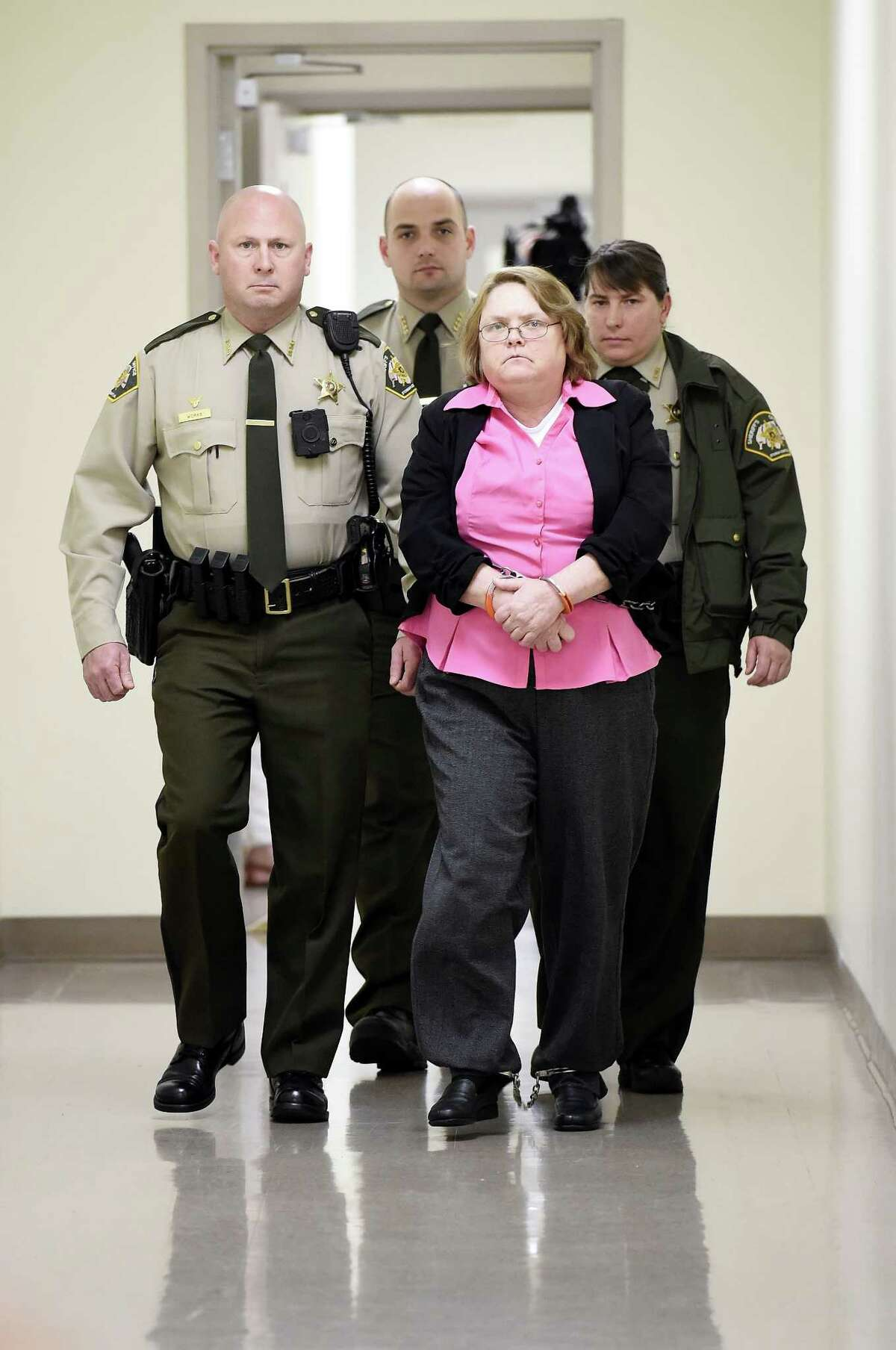 Joyce Hardin Garrard is led back to the Etowah County Detention Center in Gadsden, Ala. on Thursday, March 26, 2015, after a jury recommended she be sentenced to life in prison following her capital murder conviction. Circuit Judge Billy Ogletree will sentence Garrard on May 11 for the death of 9-year-old granddaughter, Savannah Hardin. (AP Photo/Gadsden Times, Eric T. Wright)