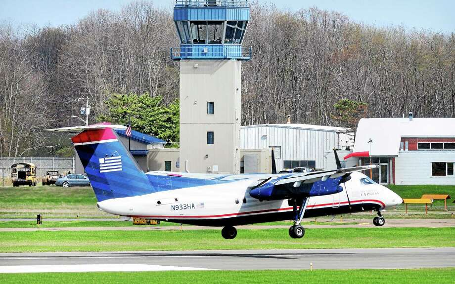 (Arnold Gold-New Haven Register file photo) A US Airways flight lands at Tweed New Haven Regional Airport on 5/2/2014. Photo: Journal Register Co.