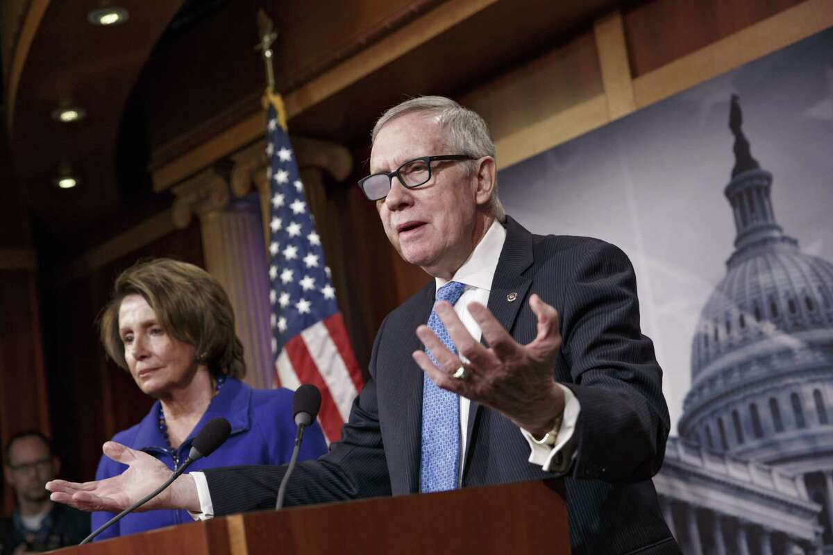FILE - In this Feb. 26, 2015 file photo, Senate Minority Leader Harry Reid of Nev., accompanied by House Minority Leader Nancy Pelosi of Calif., gestures during a news conference on Capitol Hill in Washington. Reid is announcing he will not seek re-election to another term. The 75-year-old Reid says in a statement issued by his office Friday that he wants to make sure Democrats regain control of the Senate next year and that it would be