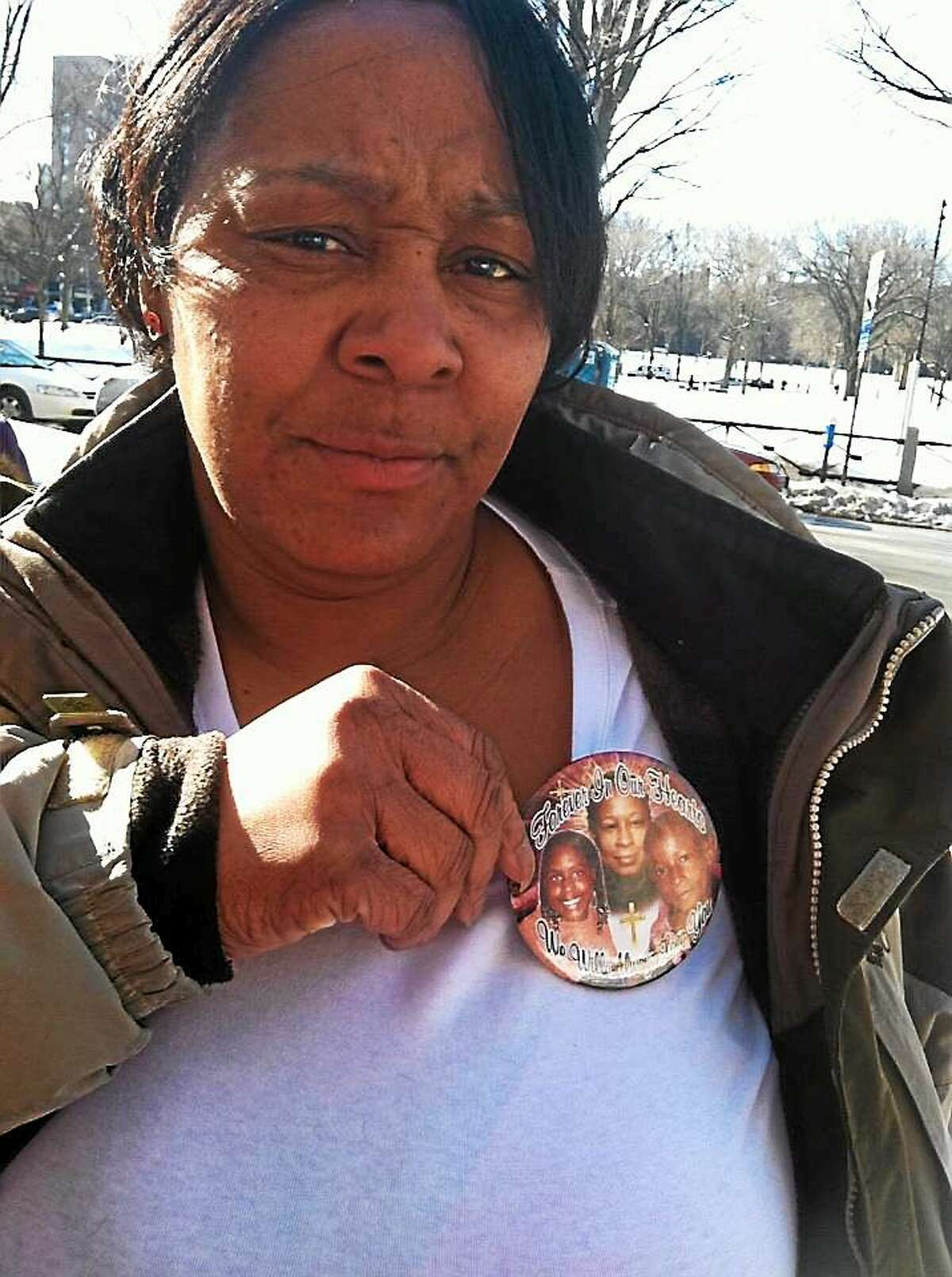 "Cassandra Roberson, sister of victim Wanda Roberson, wore a button to the sentencing, with photos of the three victims and the phrase ""Forever in our Hearts."""