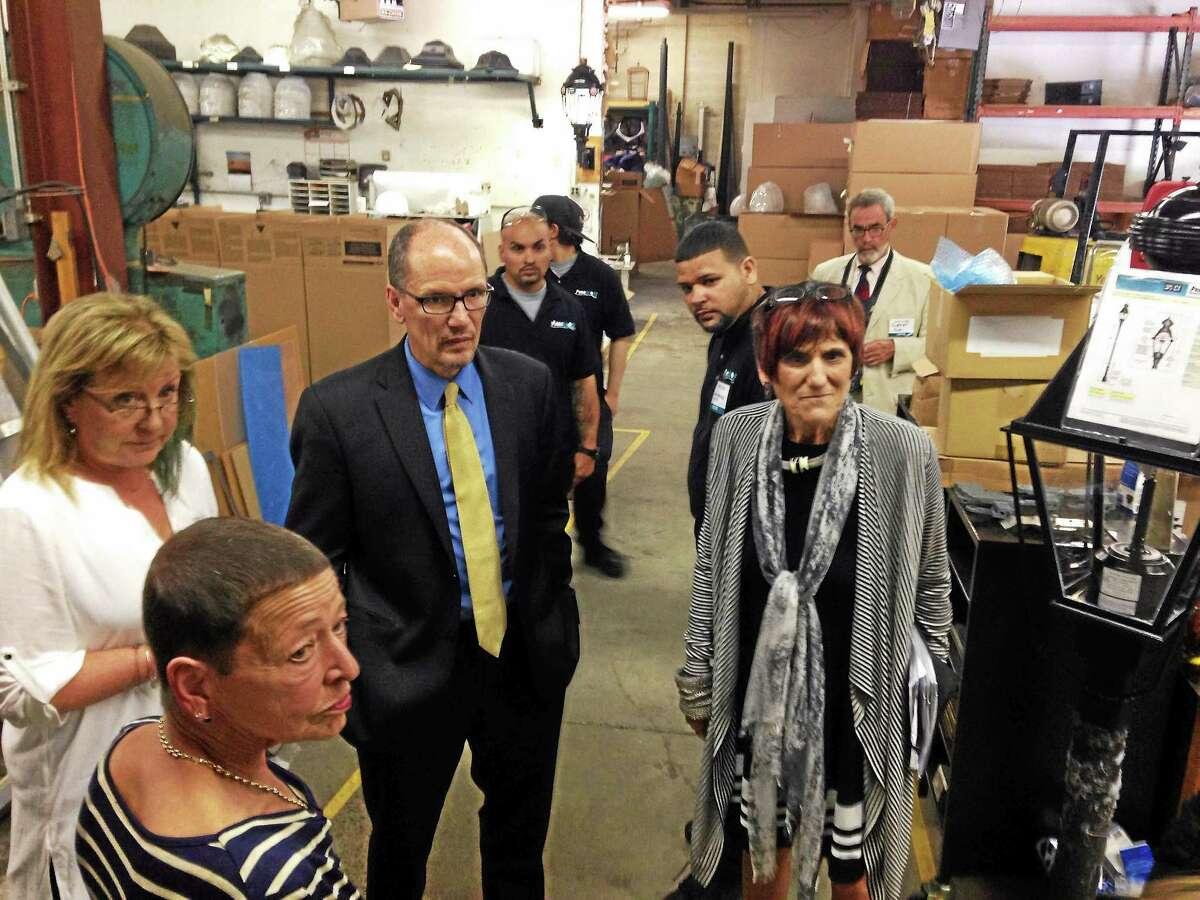 U.S. Rep. Rosa L. DeLauro and U.S. Secretary of Labor Thomas Perez tour the Penn Global facility in North Branford Thursday.