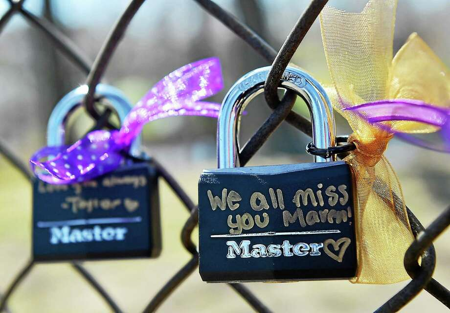 "A close-up of two of the ""Memory Locks"" sold by the junior class at Jonathan Law High School as a fundraiser to benefit the Maren Sanchez scholarship. The locks hung on the fence to the high school's athletic fields as family, friends and residents entered ""Peace Love & Music from Maren"" Saturday afternoon. Photo: Catherine Avalone — New Haven Register   / New Haven RegisterThe Middletown Press"