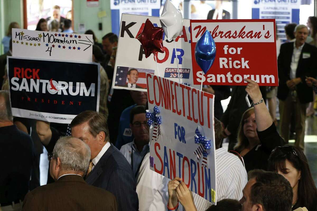 Supporters with signs showing support from other states hold them in the crowd before former U.S. Sen. Rick Santorum announced his candidacy for the Republican nomination for President of the United States in the 2016 election on Wednesday.